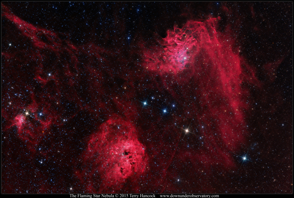 The Flaming Star Nebula (IC405) at upper right and the emission nebula IC410 at lower left.