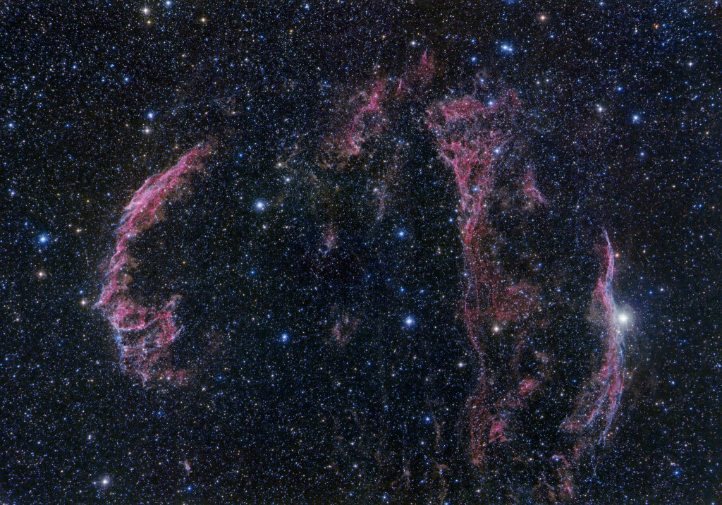 "The Veil Nebula supernova remnant. The brighter eastern section of the Veil (NGC 6992) is at left. The fainter western section at right (NGC 6960) overlaps with the star 52 Cygni. The fainter section called ""Pickering's Triangle is between the two. Credit: Terry Hancock, Downunderobservatory.com"
