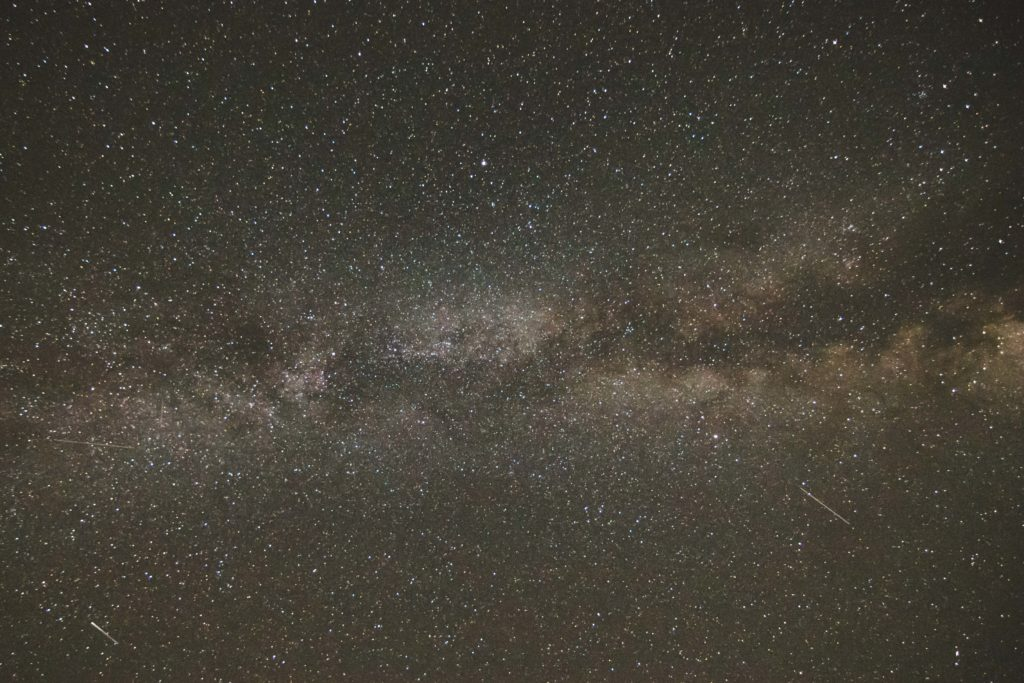 The Milky Way through the constellation Cygnus. The dark cloud bisecting the Milky Way is the Great Rift.